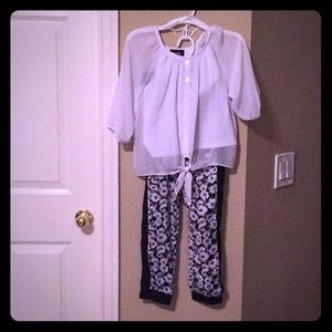 Blouse and pants.